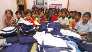 Orphan Children receiving new branded school uniforms