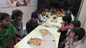 Pizza Party for poor children at SERUDS NGO